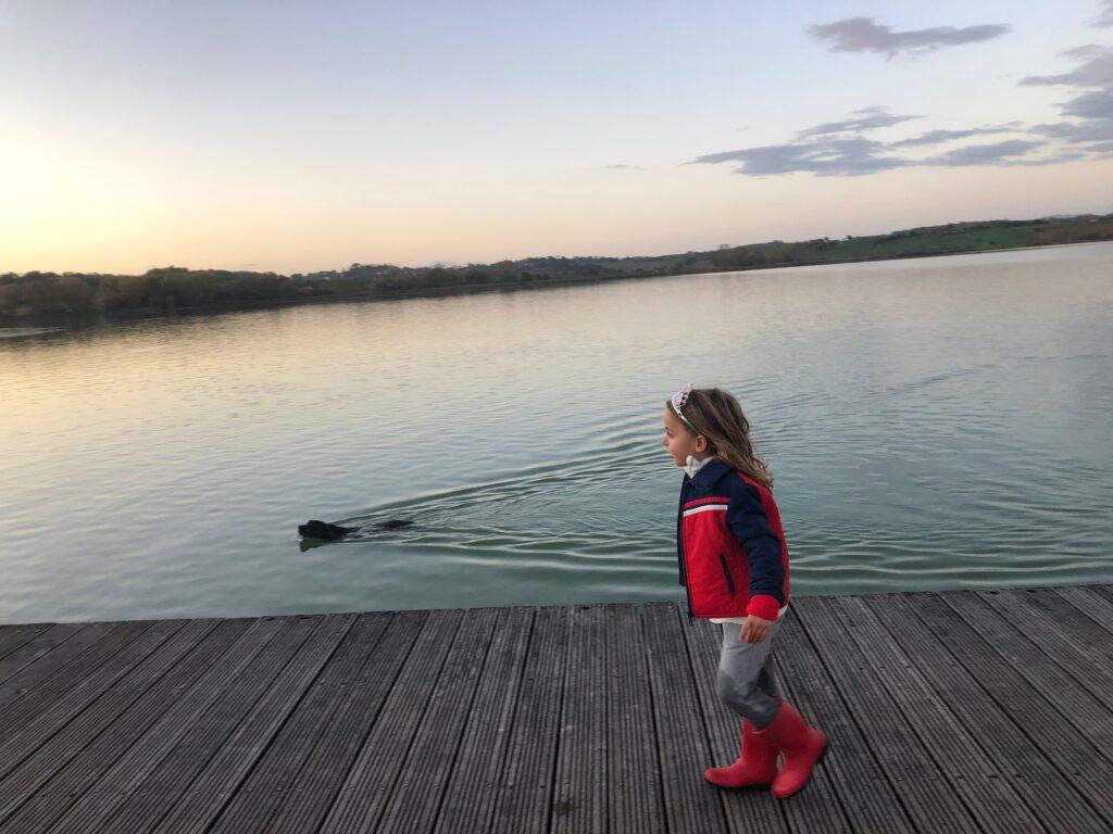 my daughter Stella and my dog Costantino at lake of Chiusi, Siena